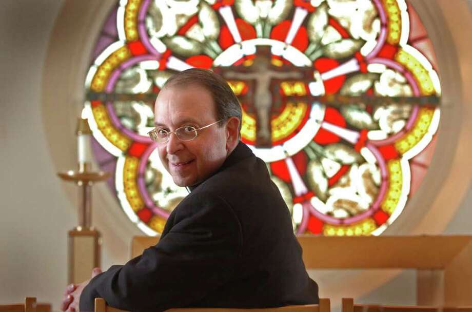 Bishop William Lori poses for a photo in the chapel at the Catholic Center in Bridgeport, Conn. in March of 2010. Photo: Autumn Driscoll, ST / Connecticut Post
