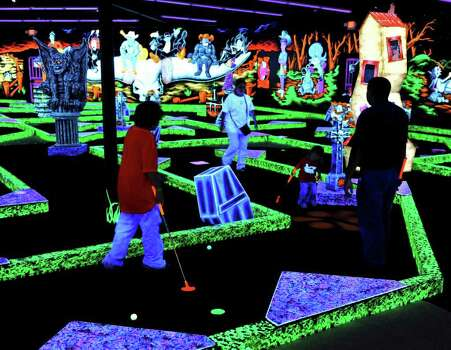 Guests Use Glow In The Dark Putters And Balls Under Black