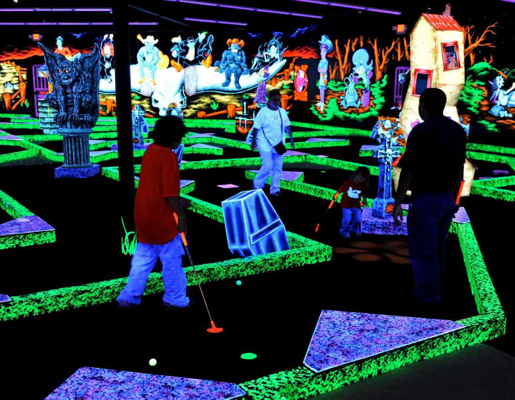 shoot for a glowing experience at monster mini golf