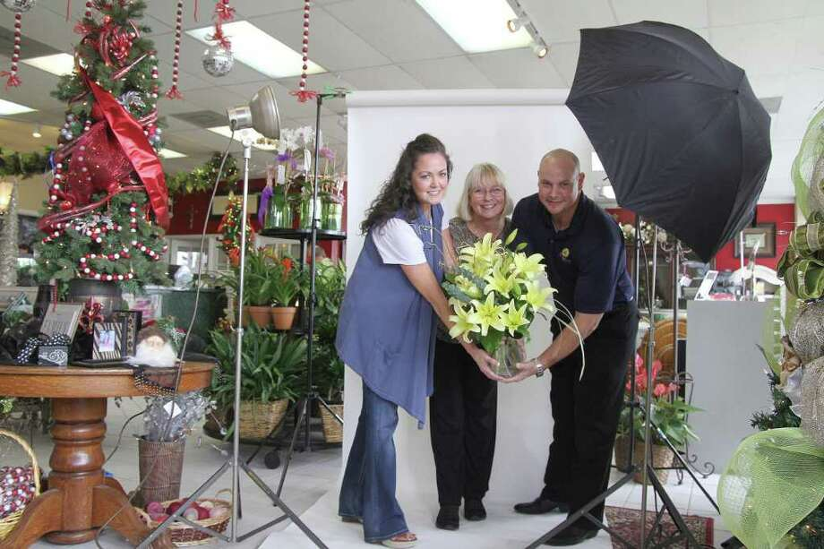 VIRAL VIDEO COMPETITION IN ACTION: Flowers and Company co-owner Alicia Aaron, left, with Debbie Grigg, who handles marketing for the company, and David Williams, operations manager, said the competition is a win-win for schools and the company. Flowers and Company  is sponsoring a viral video competition open to all area high school students. The goal is for students to create a short YouTube video about the family-owned and operated Pasadena florist to be used as a promotional tool in social media. The video that receives the most views will win $2,500 for the student's school to use in the department of its choice. Photo: Pin Lim / Copyright Pin Lim