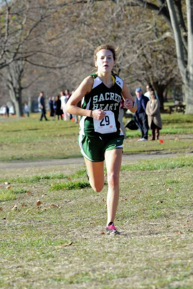 Julie Randolph, of Convent of the the Sacred Heart in Greenwich took first place in the FAA Boys and Girls Cross Country Championships at  Sherwood Island Park in Westport Monday, Nov. 7, 2011. Photo: Helen Neafsey / Greenwich Time