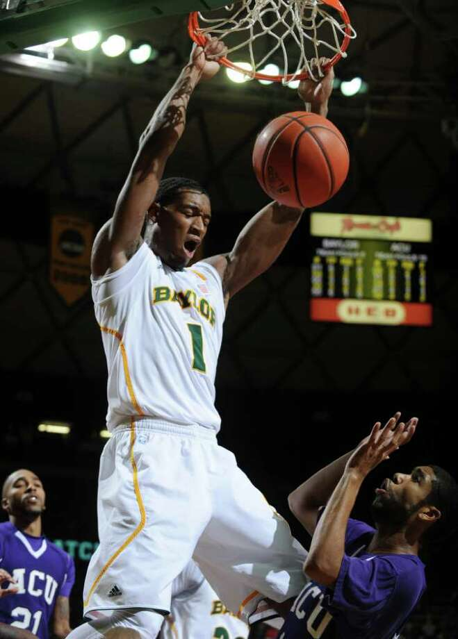 Baylor's Perry Jones III, left, scores on Abilene Christian's Antonio Bell, right,  in the first half of a NCAA college exhibition basketball game in Waco, Texas, Tuesday, Nov. 1, 2011. (AP Photo/Waco Tribune Herald, Rod Aydelotte) Photo: Rod Aydelotte / Waco Tribune Herald