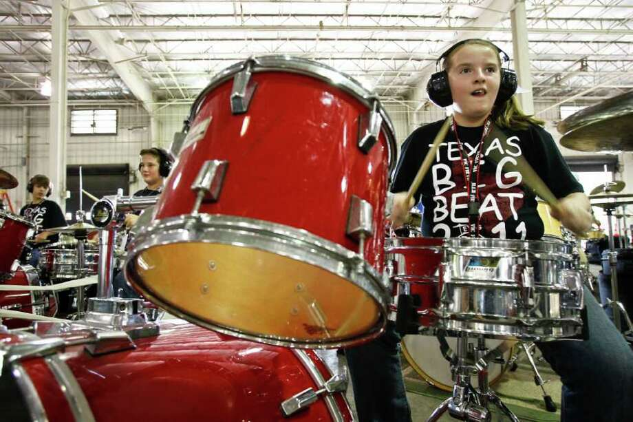 Lauren Gormly, 12, plays her drums during the 5th Annual Texas BigBeat drumming charity event which aims to create a new World Record of drumset players playing simultaneously in multi cities, at the Bush Intercontinental Airport Services Complex, Sunday, Nov. 6, 2011, in Houston. Photo: Michael Paulsen, Houston Chronicle / © 2011 Houston Chronicle