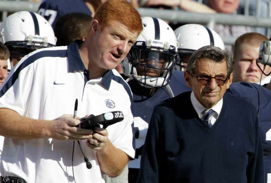 FILE - In this Oct. 8, 2011 file photo, Penn St. assistant football coach Mike McQueary, left, talks with head coach Joe Paterno during an NCAA college football game against Iowa,  in State College, Pa. Penn State Athletic Director Tim Curley and Gary Schultz, the school's senior vice president for business and finance, face arraignment Monday, Nov. 7, 2011, on charges they lied to a grand jury investigating former defense coordinator Jerry Sandusky and failed to properly report suspected child abuse, a case that has left fans reeling. In 2002, State Attorney General Linda Kelly said, a graduate assistant, identified by two people familiar with the investigation as McQueary, saw Sandusky sexually assault a naked boy, estimated to be about 10 years old, in a team locker room shower.  (AP Photo/Gene Puskar, File) Photo: Gene J. Puskar