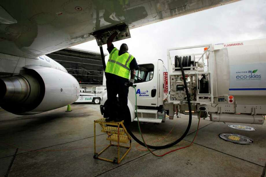 Monte Hawkins, lead aircraft refueler, fills the taxi'd aircraft with biofuel, prior to the first US commercial flight powered by advanced biofuel, Monday, November 7, 2011 at George Bush Intercontinental Airport in Houston, Texas. The Boeing 737 departed terminal E at 10:30am and was bound for Chicago O'Hare International Airport. (Todd Spoth / For The Chronicle) Photo: TODD SPOTH / Todd Spoth