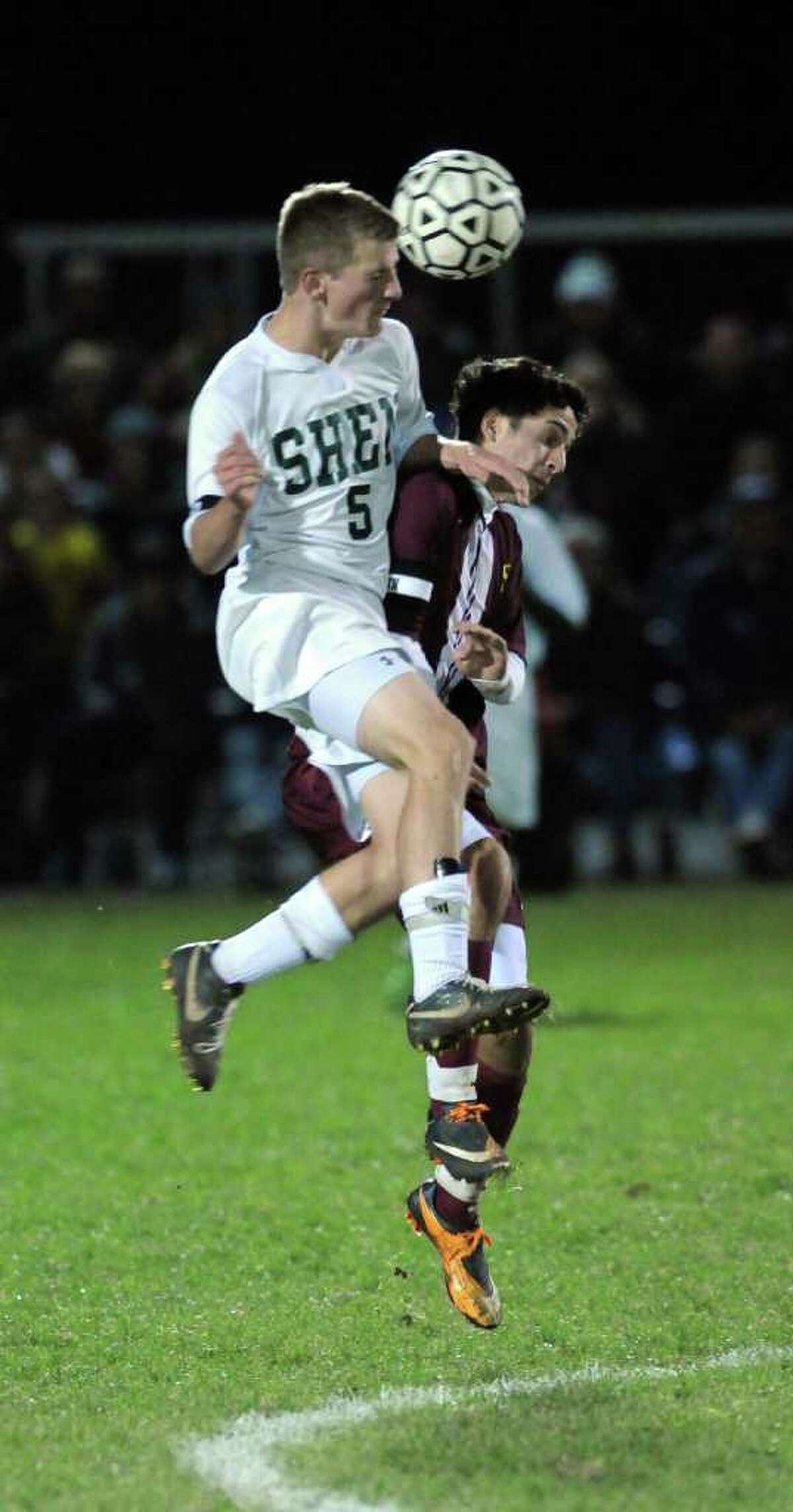 Shenendehowa's Philip Barrett, left, battles Colonie's Massimo Smiroldo, right, during Shen's 2-1 victory in the Section II Class AA championship game on Monday night Nov. 7, 2011 in Colonie, NY. (Philip Kamrass / Times Union )