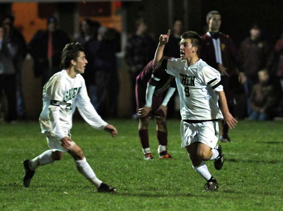 Shenendehowa's Adam Barlow, right, celebrates after scoring his team's second goal in the second half of their 2-1 victory over Colonie in the Section II Class AA championship game on Monday night Nov. 7, 2011 in Colonie, NY. Teammate Dan Cavosie is at left. (Philip Kamrass / Times Union )