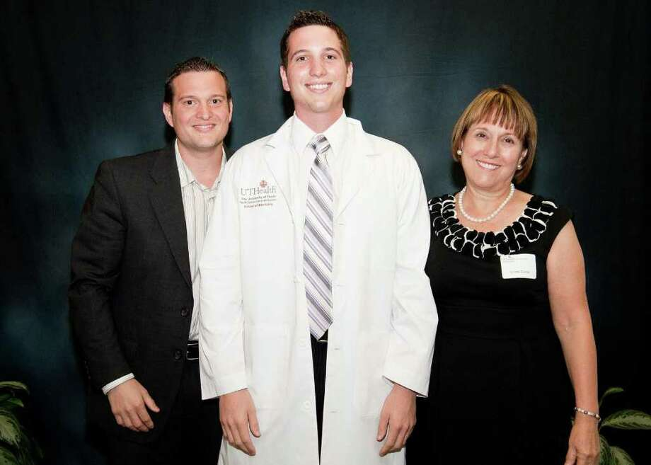COURTESY SIERRA COSMETIC AND FAMILY DENTISTRY ALL SMILES: Sierra Cosmetic and Family Dentistry, 4421 Vista Road in Pasadena, is a family affair that includes Dr. James Thomas Sierra, left, Dr. Christopher Brian Sierra, and their mother, Dr. Linda Sierra. Photo: COURTESY Dr. Linda Sierra