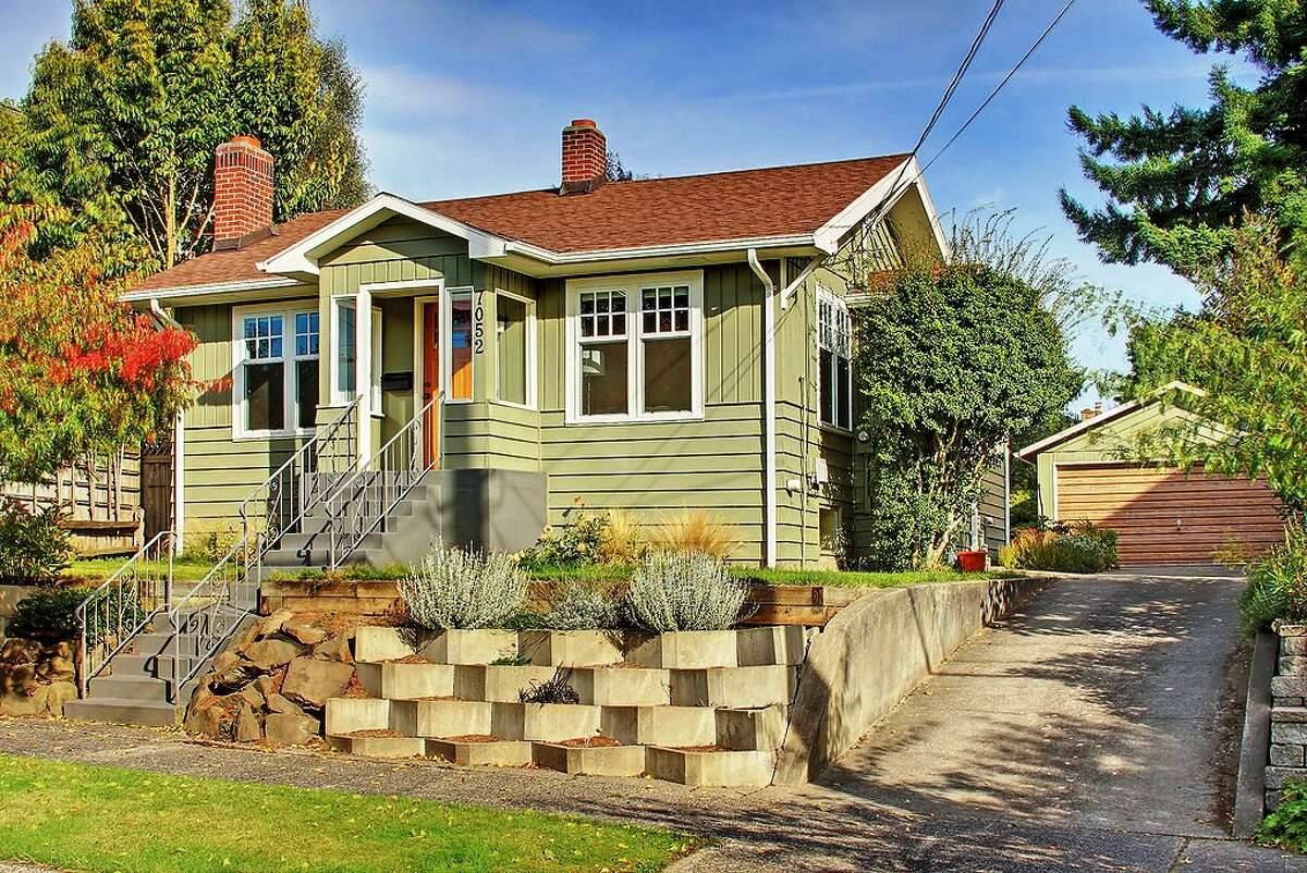 Following up on last week's real estate profile gallery of Sunset Hill homes up to $500,000, here are homes in the same price range in neighboring Loyal Heights. This 1924 home, at 7052 26th Ave. N.W., is 2,130 square feet, with two bedrooms and a tiled bathroom on the main floor and two bedrooms, a three-quarter bathroom and second kitchen in a basement mother-in-law apartment. The house also has a brick fireplace, updated kitchen and two-car garage on the 5,100-square-foot lot. It's listed for $500,000.