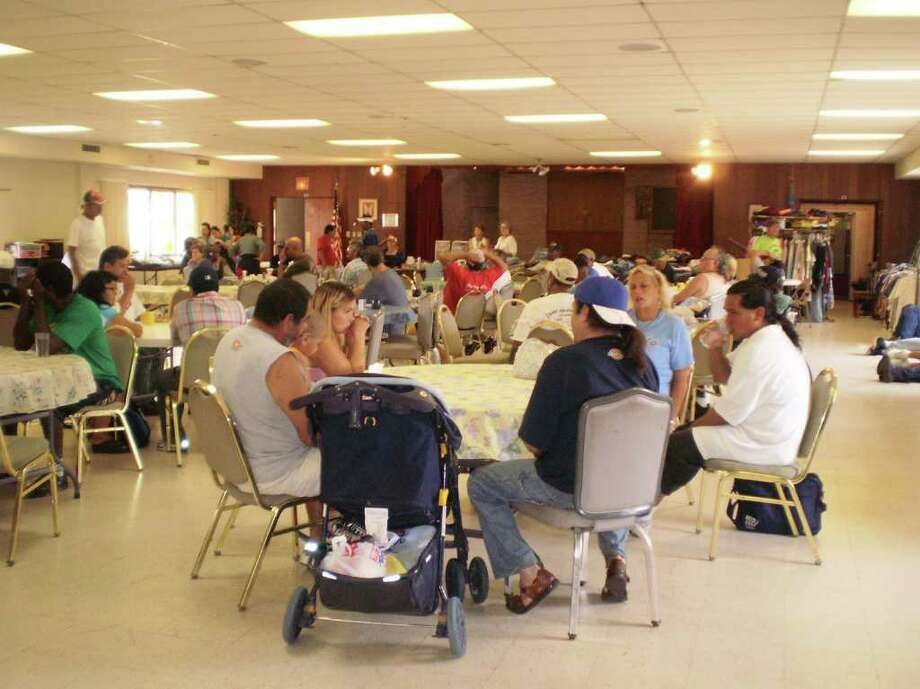 OUTREACH: Crossroads was founded by Park Place United Methodist Church (now Servants of Christ United Methodist Parish), St. Paul s Episcopal Church and Glenbrook United Methodist Church in response to the number of people who reached out to churches for aid. Photo: COURTESY CROSSROADS