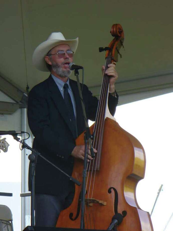 MUSIC MAN: Webster resident Ed Fryday has been playing bluegrass music since he was 14. He's pictured here with his 1955 Kay bass fiddle, but he also plays guitar, mandolyn and mountain dulcimer. Photo: COURTESY BECKY FRYDAY
