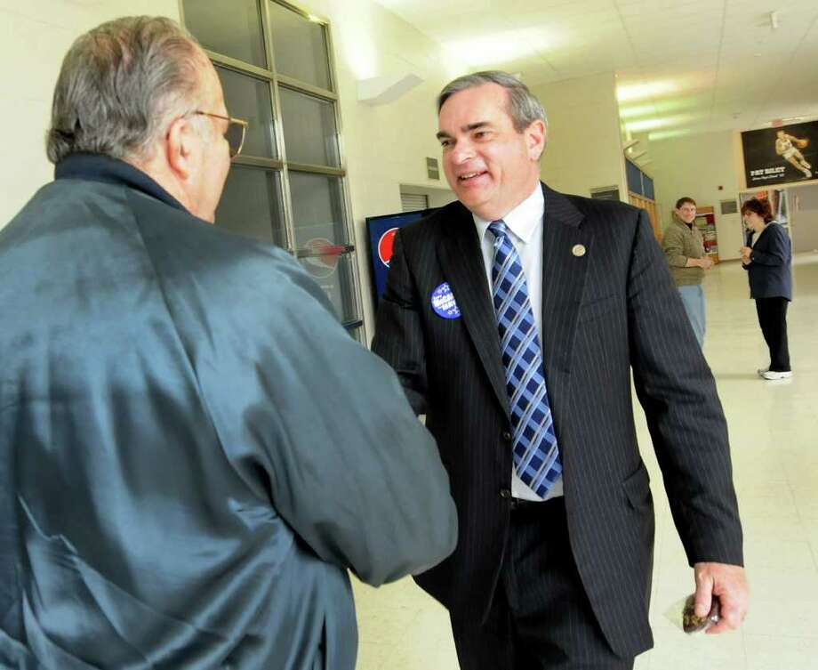 Mayoral candidate Gary McCarthy, right, greets Dick Howland, left, on Election Day on Tuesday, Nov. 8, 2011, at Schenectady High in Schenectady, N.Y. (Cindy Schultz / Times Union) Photo: Cindy Schultz / 00015306A