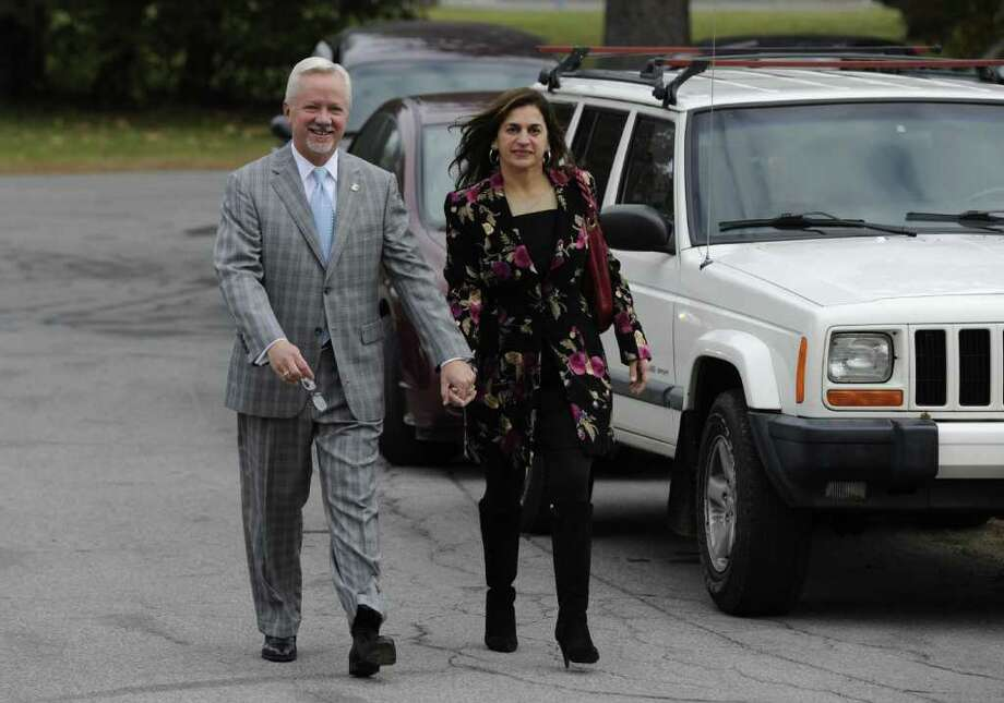 Incumbent Saratoga Springs Mayor Scott Johnson accompanied by his wife Julia walks to the poling place at the Lincoln Baths in Saratoga Springs, N.Y. November 8, 2011.    (Skip Dickstein/Times Union) Photo: Skip Dickstein / 00015290A