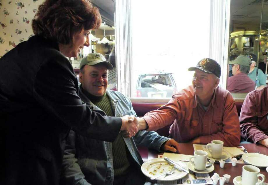 Photo special to the Times Union by Alexis Willey:  Colonie Supervisor candidate Denise Sheehan, left, greets the breakfast crowd at the Farmer Boy diner Tuesday Nov. 8, 2011. Photo: Alexis Willey / 00015319A