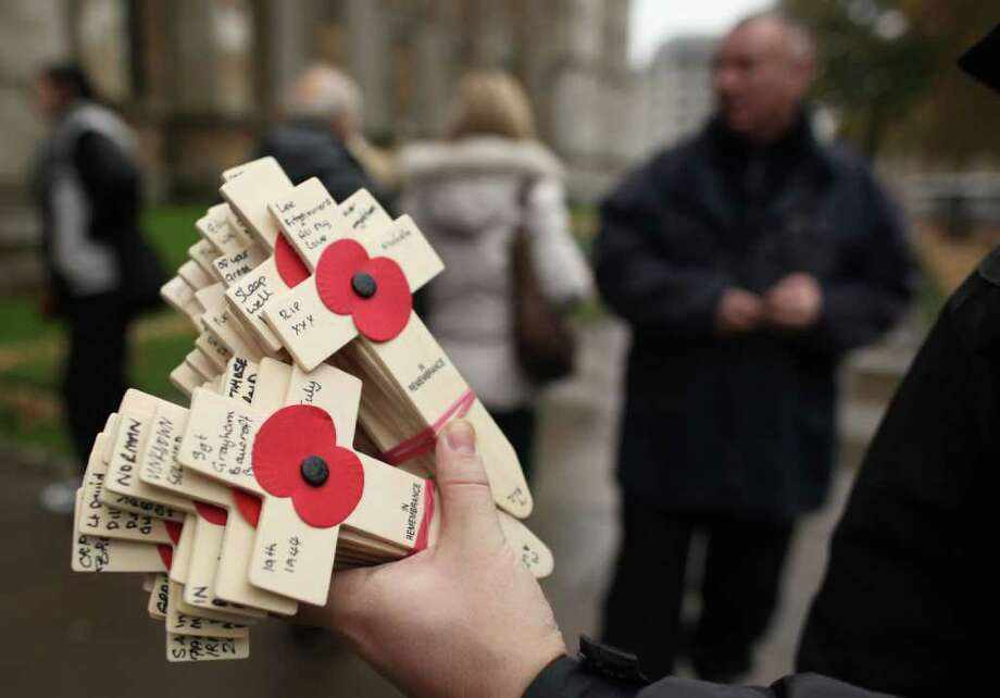 Remembrance crosses are planted outside Westminster Abbey ahead of the official opening of the Royal British Legion's Field of Remembrance on November 8, 2011 in London, England. Hundreds of small crosses bearing a poppy have been planted in the Field of Remembrance to pay tribute to British servicemen and women who have lost their lives in conflict. Photo: Dan Kitwood, Getty / 2011 Getty Images