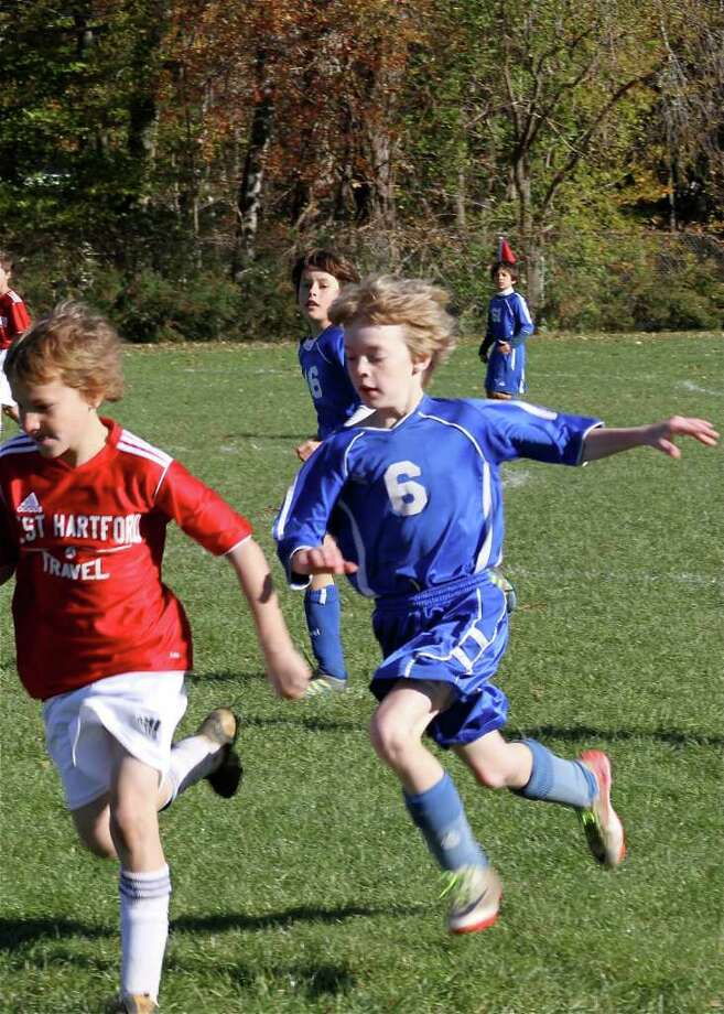 Midfielder Benjamin Hickman chases the ball during the U11 OGRCC Thunder Blue's recent match against West Hartford. The Thunder Blues won 3-1 and will play in the state championship game - for the Connecticut Junior Soccer Association's Connecticut Cup - on Sunday. Photo: Contributed Photo