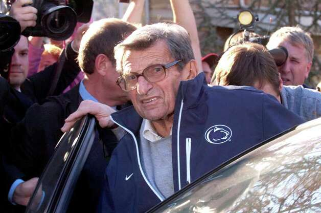 Embattled Penn State football coach Joe Paterno gets into a car outside his home on Tuesday. Paterno's weekly news conference was canceled. Photo: AP Photo/York Daily Record,  Jason Plotkin