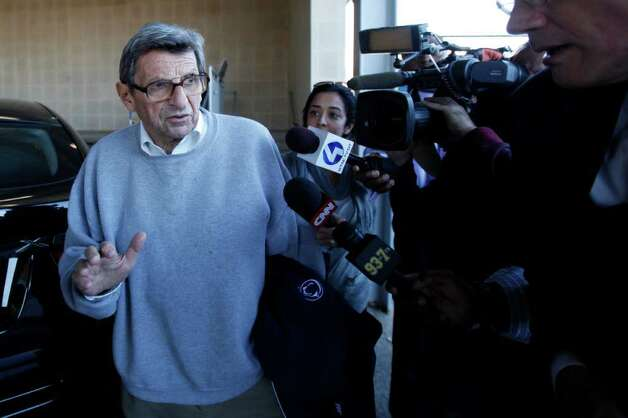 "Penn State football coach Joe Paterno leaves the Louis and Mildred Lasch Football Building on the school campus in State College, Pa., Tuesday Nov. 8, 2011. Paterno's support among the Penn State board of trustees was described as ""eroding"" Tuesday, threatening to end the 84-year-old coach's career amid a child sex-abuse scandal involving a former assistant and one-time heir apparent. Photo: AP"
