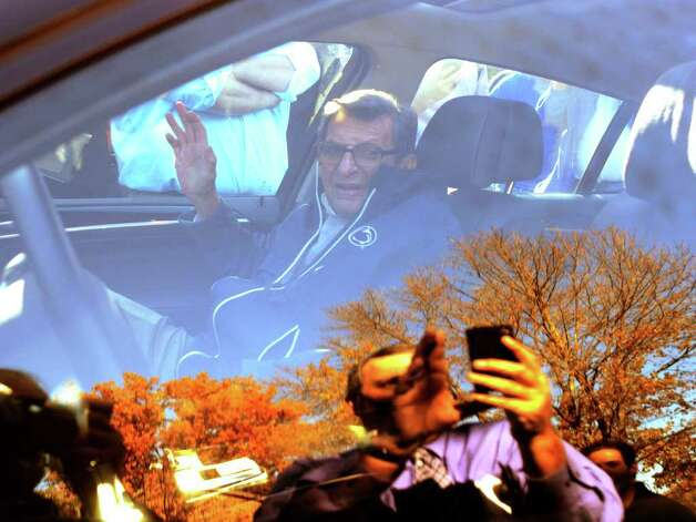 "Penn State football coach Joe Paterno leaves his home in State College, Pa., Tuesday Nov. 8, 2011. Paterno's support among the Penn State board of trustees was described as ""eroding"" Tuesday, threatening to end the 84-year-old coach's career amid a child sex-abuse scandal involving a former assistant and one-time heir apparent. Photo: AP"