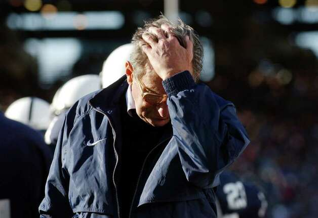 FILE - In this Nov. 6, 2004 file photo, Penn State football coach Joe Paterno pauses on the sidelines during the fourth quarter of his team's 14-7 loss to Northwestern,  in State College, Pa. A high-ranking Penn State official says support for football coach Paterno is eroding among the school's board of trustees. The person spoke to The Associated Press on Tuesday, Nov. 8, 2011,  on condition of anonymity because of the sensitivity of the topic. The person is familiar with the trustees' discussions but says it's unclear what the consequences for Paterno will be. Photo: AP