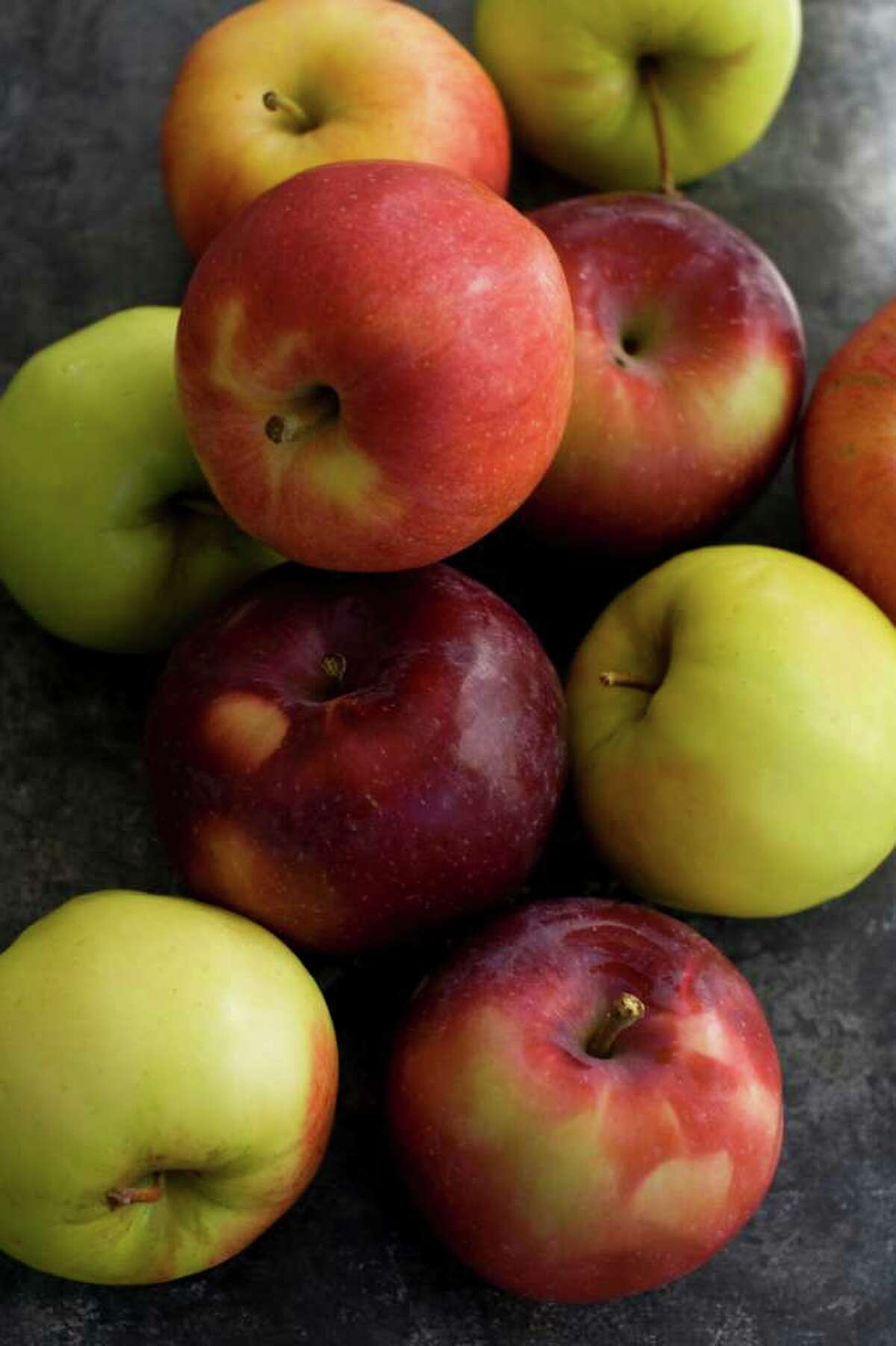 MATTHEW MEAD : ASSOCIATED PRESS quality display: From apple pie to the applesauce that accompanies everything from pork chops to latkes, apples always have a place at the table.