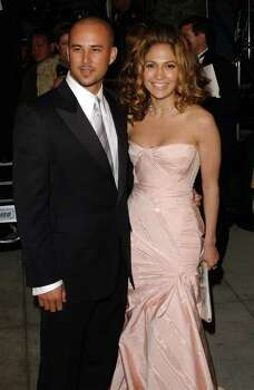 ABACA  SWEPT OFF HER FEET: Jennifer Lopez and Cris Judd Photo: LIONEL HAHN / ABACA