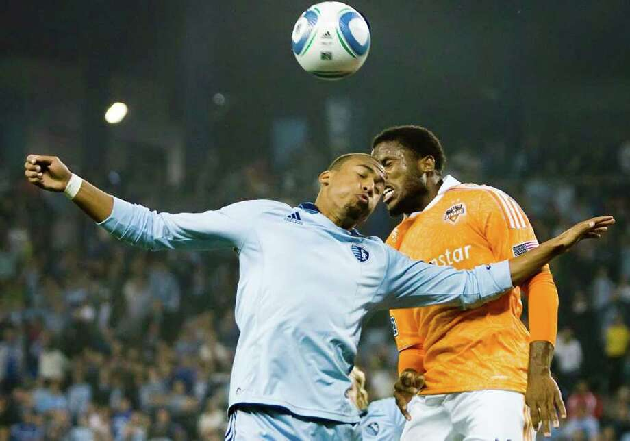 TEAM EFFORT: Jermaine Taylor, right, came on Sunday when Brad Davis was injured against Sporting Kansas City, and the Dynamo didn't skip a beat. Photo: Shane Keyser / Kansas City Star