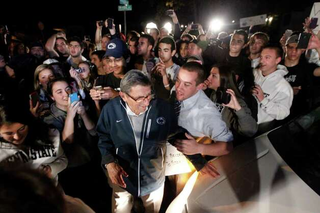 "Students greet Penn State football coach Joe Paterno as he arrives at his home, Tuesday, Nov. 8, 2011, in State College, Pa. Paterno's support among the Penn State board of trustees was described as ""eroding"" Tuesday, threatening to end the 84-year-old coach's career amid a child sex-abuse scandal involving a former assistant and one-time heir apparent. Photo: AP"
