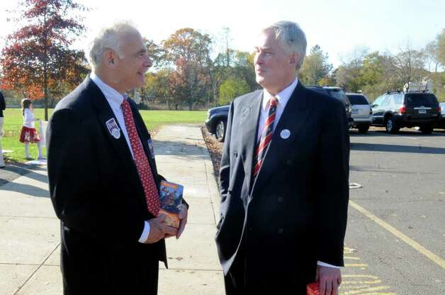 Bill Grad, the Democratic candidate for tax collector, left, speaks with Sean Goldrick, a Democratic candidate for the Board of Estimate and Taxation, outside the Old Greenwich School polling station Tuesday, Nov. 8. 2011. Photo: Helen Neafsey / Greenwich Time