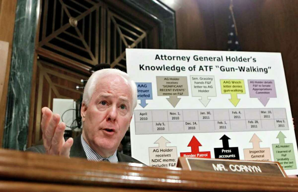 """PHOTOS BY J. SCOTT APPLEWHITE : ASSOCIATED PRESS TIMELINE CHALLENGED: Sen. John Cornyn, R-Texas, presses Attorney General Eric Holder about when he learned of the controversial """"Operation Fast and Furious"""" gunrunning program during Tuesday's Senate Judiciary Committee hearing."""