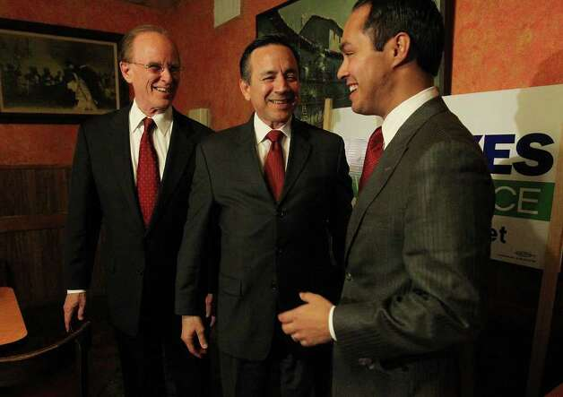 Bexar County Judge Nelson Wolff (from left), State Senator Carlos Uresti and Mayor Julian Castro were all smiles as early voting results favored the trio in dissolving the BexarMet Water District and its board on Tuesday, Nov. 8, 2011. BexarMet has been plagued with controversy and corruption for the past several years. Kin Man Hui/kmhui@express-news.net Photo: Kin Man Hui, SAN ANTONIO EXPRESS-NEWS / San Antonio Express-News