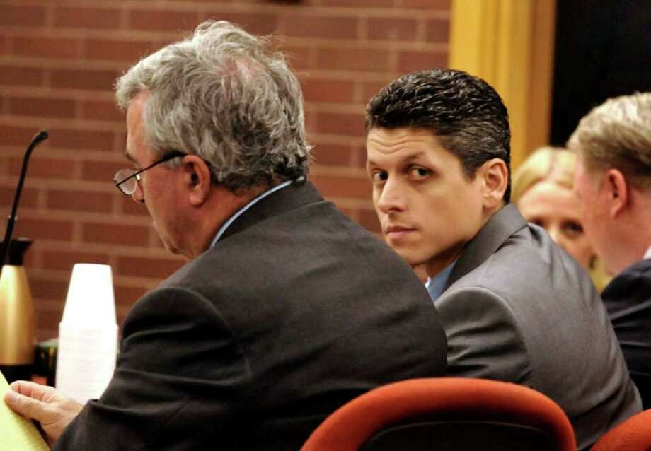Marash Gojcaj sits with his attorneys in Superior Court in Danbury in this Sept. 29, 2010 file photo. Photo: File Photo/ Michael Duffy, ST / The News-Times File Photo