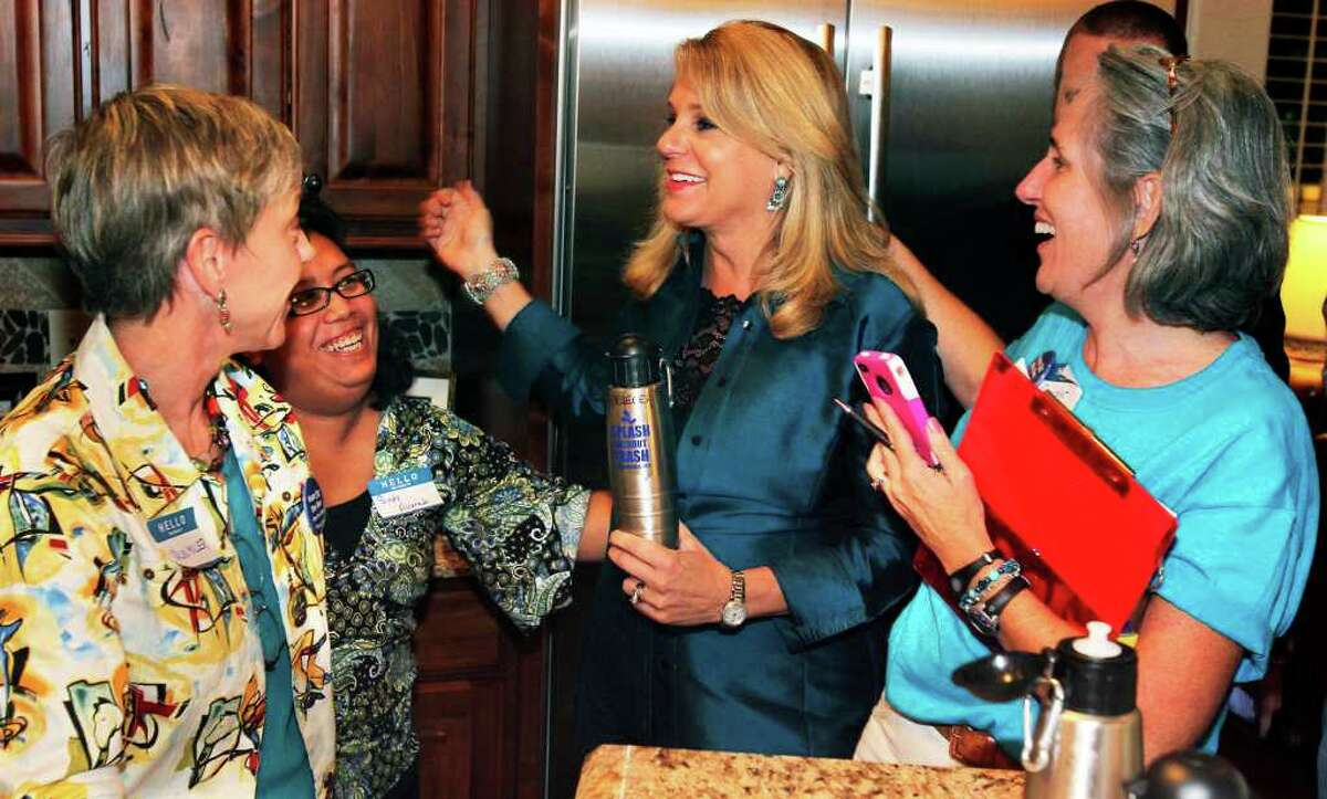 METRO Former New Braunfels mayor pro-tem Kathleen Krueger (center) celebrates early polling results showing a large lead for her side (the pro ban side) with friends (from left) Valin Miller, Sindy Alvarado and Chandler Gray. Tom Reel/Staff