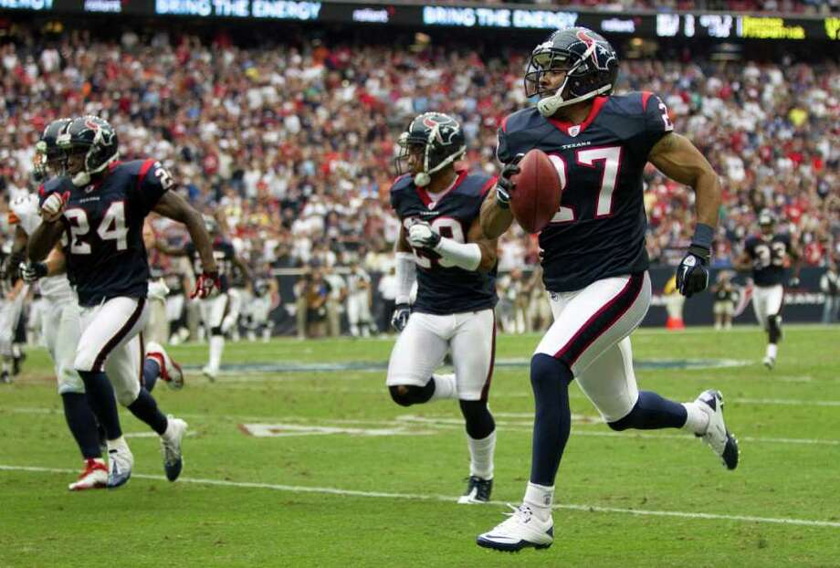HAPPY RETURN: Quintin Demps jump-starts his second stint with the Texans with an interception against the Browns. Photo: Brett Coomer / © 2011  Houston Chronicle