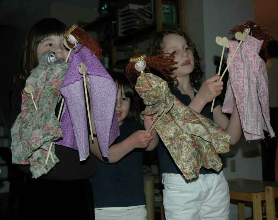 Students are in charge of the story with ìchopstick puppets.î Photo: Contributed Photo