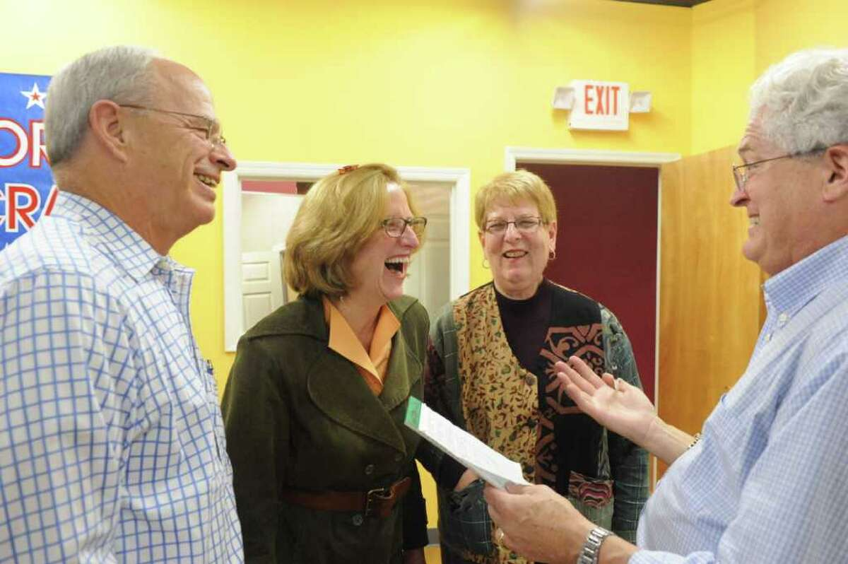 Ron Malloy, right, and his brother Bill Malloy with Democratic Board of Education candidates Jackie Heftman and Julia Wade at Democratic Headquarters on High Ridge Road in Stamford, Conn., November 8, 2011.