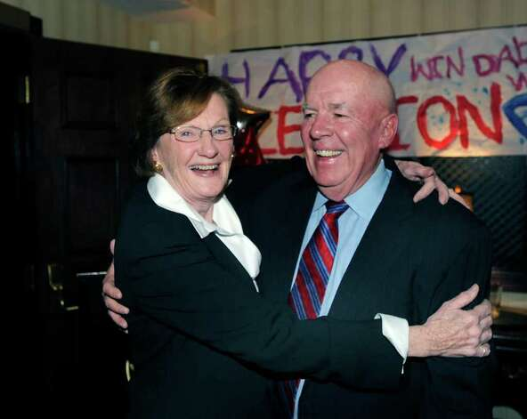 Barbara O'Neill celebrates her election victory to the Board of Education with her husband John at the Milbrook Club, Greenwich, Tuesday night, Nov. 8, 2011. Photo: Bob Luckey / Greenwich Time