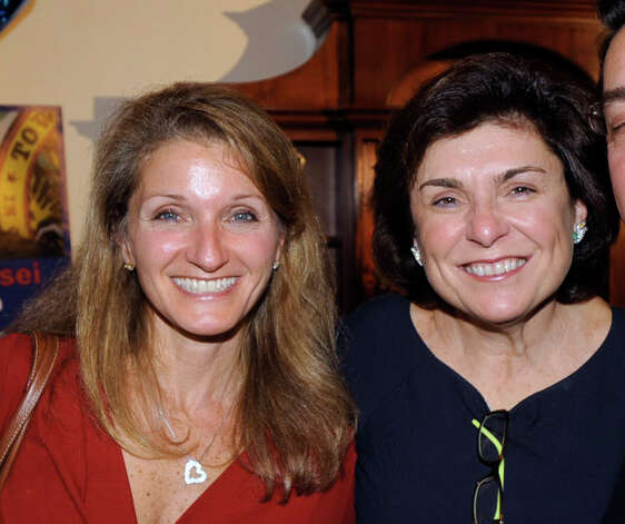 Anna Saras Povinelli, left, and Marianna Ponns Cohen, both lost their bids to get elected to the Board of Education, at the Milbrook Club on election night, Greenwich, Tuesday night, Nov. 8, 2011. Photo: Bob Luckey / Greenwich Time