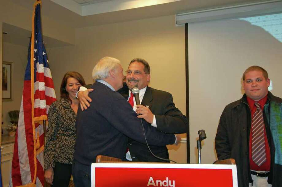 Mayoral candidate Andy Garfunkel hugs his dad Ken before he makes his concession speech at the Norwalk Inn as Ann Bloom and  his son Justin look on. Photo: Nicole Rivard