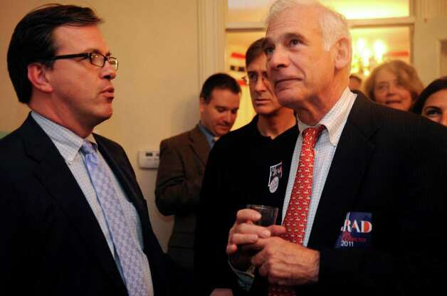 Democratic Town Committee Chairman Frank Farricker speaks with Bill Grad, the party's candidate for tax collector at the Democratic campaign headquarters Tuesday, Nov. 8, 2011. Photo: Helen Neafsey / Greenwich Time