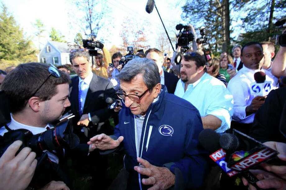 Penn State football coach Joe Paterno briefly answers a few questions before leaving his house for practice on Tuesday, November 8, 2011 in State College, Pennsylvania. (David Swanson/Philadelphia Inquirer/MCT) Photo: DAVID SWANSON, McClatchy-Tribune News Service / Philadelphia Inquirer