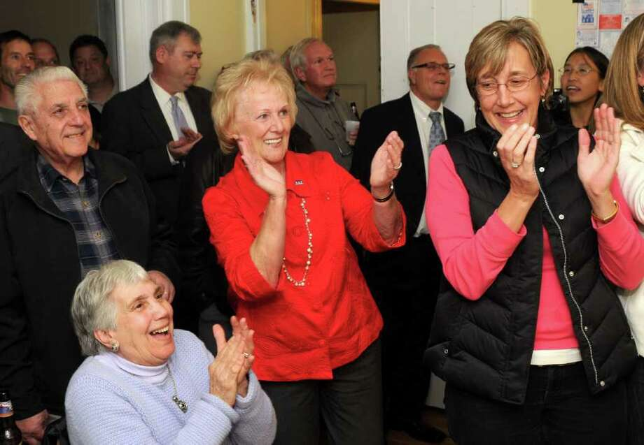 Newtown First Selectman Pat Llodra, surrounded by supporters, enjoys her re-election moment. Photo taken Tuesday, Nov. 8, 2011. Photo: Jay Weir / The News-Times Freelance