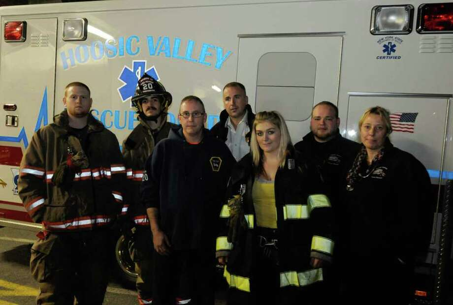 Member of the Melrose Fire Department and Hoosic Valley Rescue who helped deliver a baby at a polling place ,left to right, Brett Blanck, Edward J. Madlin-Whitney, Robert Loya, Dominic Pasinella Jr., Jessica Valyou, Richard Thompson and Holly Connors  in Melrose, NY Tuesday, Nov.8, 2011.( Michael P. Farrell/Times Union) Photo: Michael P. Farrell