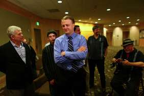 Tim Eyman and supporters wait for results at an Initiative 1125  press event on Tuesday, November 8, 2011 at the Westin Hotel in Seattle.