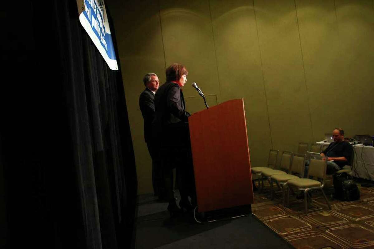 Katherine Stanger from the Coalition For 1183 and Bruce Beckett, director of government affairs for the Washington Restaurant Association, speak at a Yes on 1183 press event on Tuesday, November 8, 2011 at the Westin Hotel in Seattle. The initiative ending state-run liquor stores appeared to be passing.