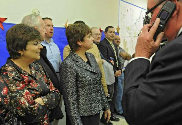 Colonie Town Supervisor Paula Mahan, middle, looks as results are posted on a wall as she gathers with supporters in Colonie, N.Y. on Tuesday, Nov. 7, 2011. (Lori Van Buren / Times Union) Photo: Lori Van Buren
