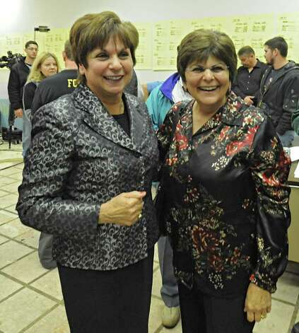 Colonie Town Supervisor Paula Mahan, left, gets congratulated by her sister Donna Barry after declaring victory in Colonie, N.Y. on Tuesday, Nov. 7, 2011. (Lori Van Buren / Times Union) Photo: Lori Van Buren