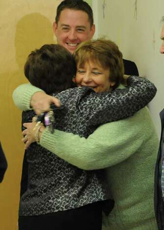 Colonie Town Supervisor Paula Mahan, left, gets congratulated by Jean Donovan of Colonie after declaring victory in Colonie, N.Y. on Tuesday, Nov. 7, 2011. (Lori Van Buren / Times Union) Photo: Lori Van Buren