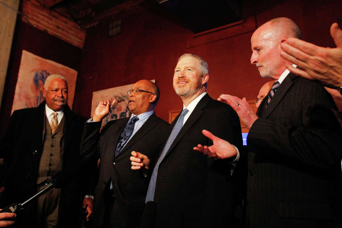 Former Seattle Mayor Norm Rice, left center, and current Seattle Mayor Mike McGinn at right center, celebrate after learning that a $232 million Seattle education levy passed.