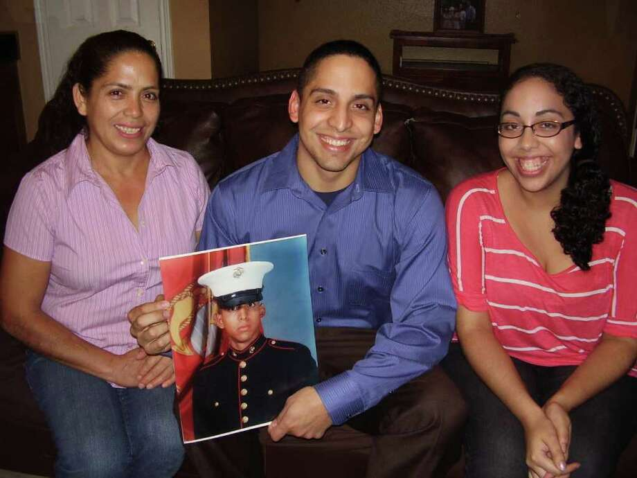 BRYAN KIRK: FOR THE CHRONICLE COMBAT VETERAN: Justo Jaimes, a U.S. Marine veteran, is flanked by his mother Antonia Jaimes, left, and his sister, Hilda Jaimes. He is studying at Lone Star College to become a foreign language specialist.